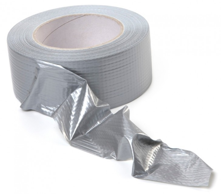 Fortified silver adhesive tape on roll.